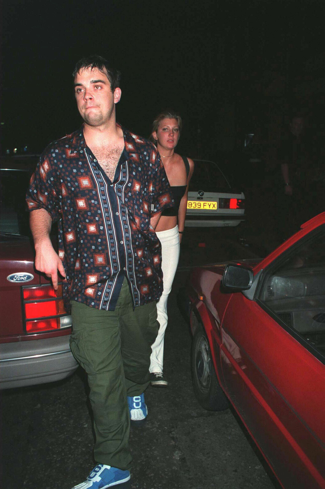 ROBBIE WILLIAMS WITH MYSTERY WOMAN