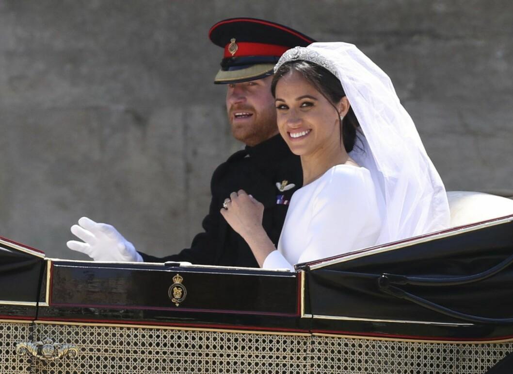Prins Harry och Meghan Markle ler.
