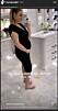 Jonna Lundell i svart klänning visar upp bebismage