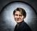 Markus Krunegård i svart tröja med bakgrund