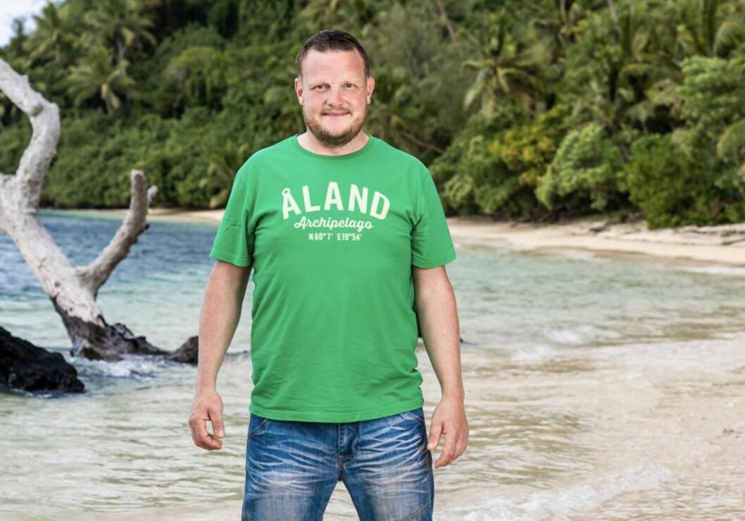Michael Björklund i Robinson 2020, grön tröja Åland